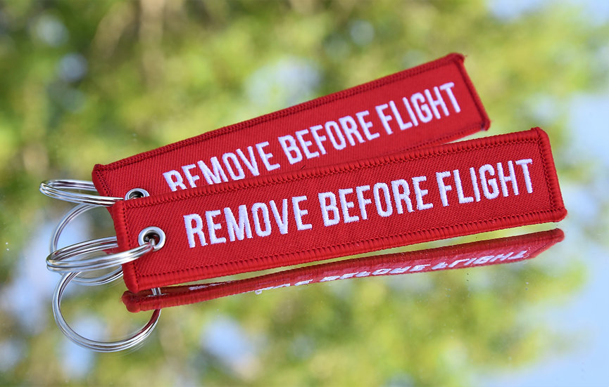 "WAR TORN ARCHERY ""REMOVE BEFORE FLIGHT"" KEYCHAIN"