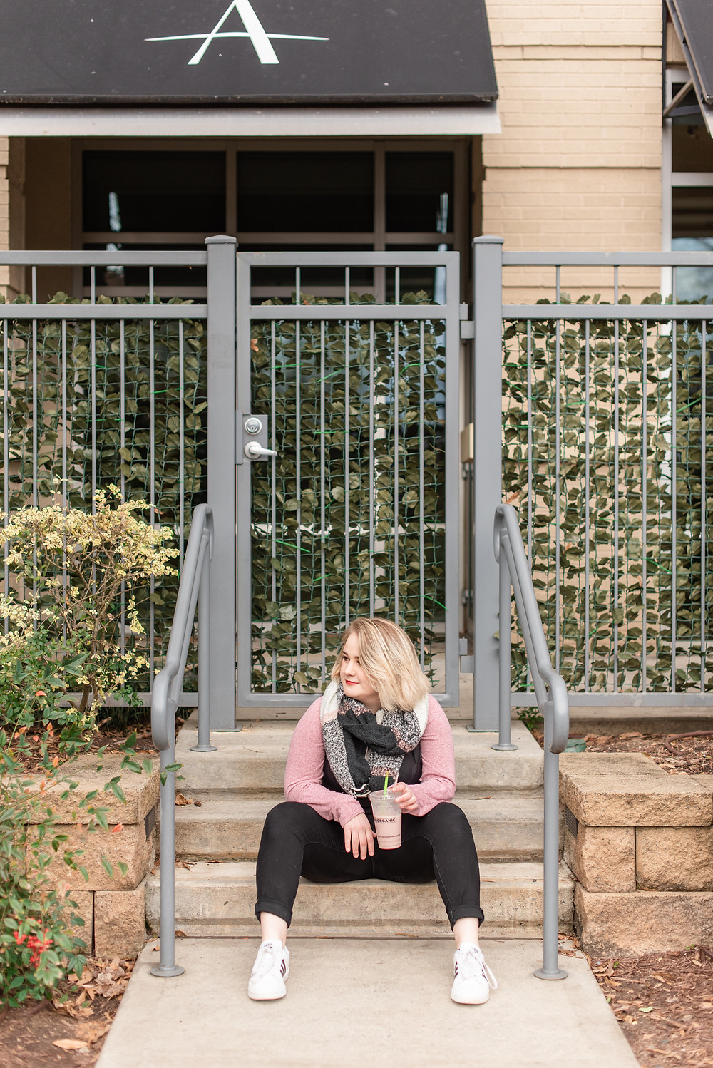 Photo of Megan Oliveri sitting on a stoop in Charlotte, NC