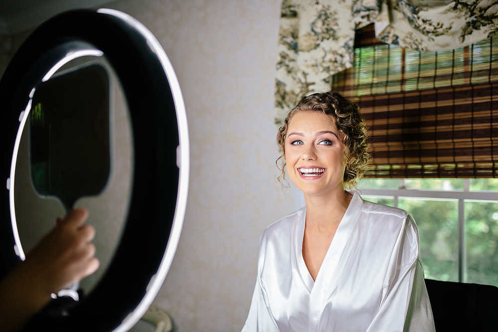beautiful bride with stunning hair and makeup on wedding day in charlotte nc