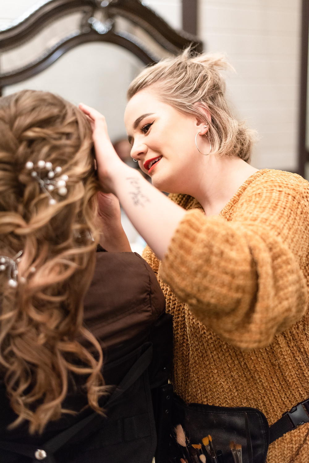 Megan working on a client at a photoshoot at Providence Cotton Mill
