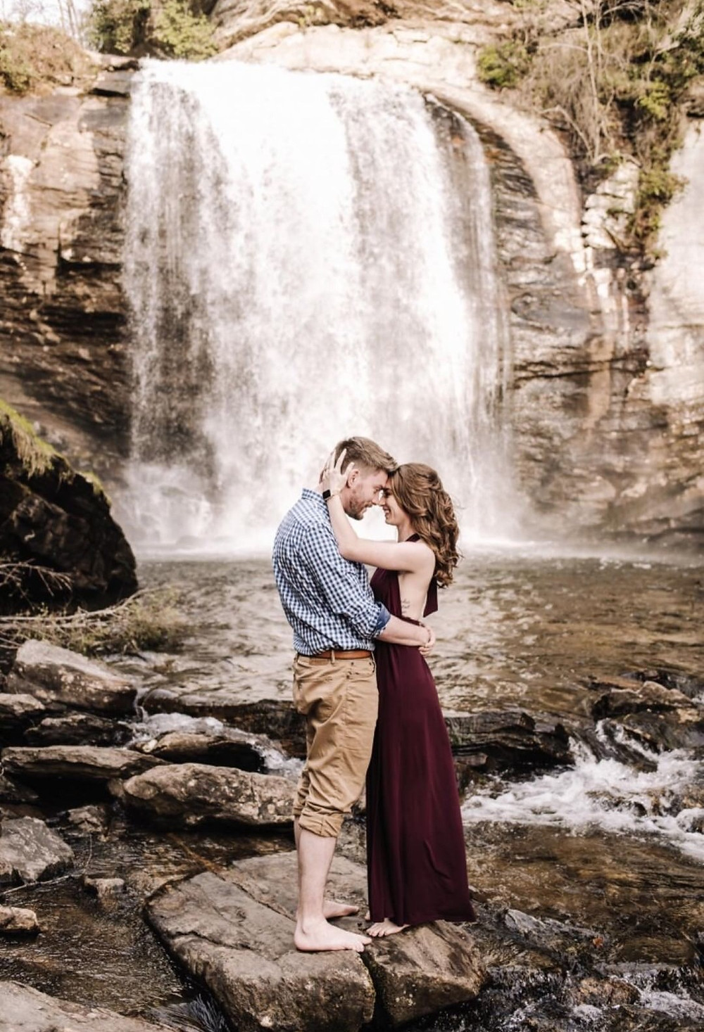 professional image by Rebekah Torres Photography in front of a waterfall in western North Carolina