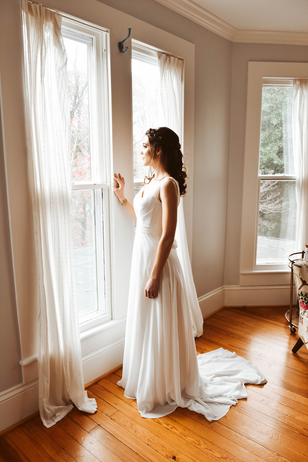 photo of bride standing by window at ritchie hill, nc