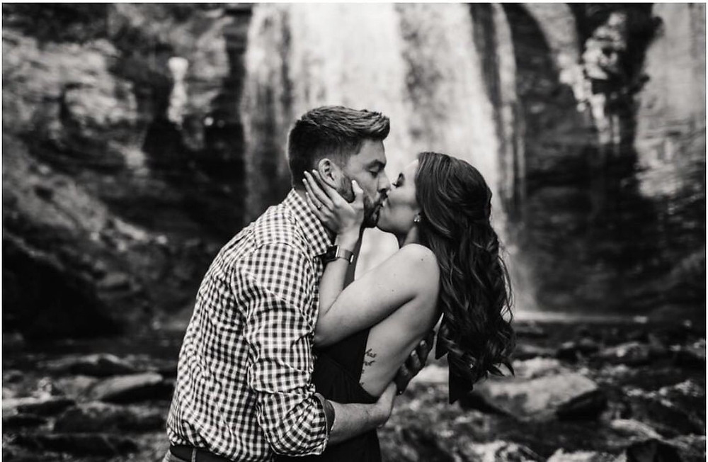 Couple Kissing in front of a waterfall in western north carolina