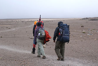 Climbers crossing the saddle between Mawenzi and Kibo, Mt. Kilimanjaro