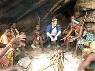 Hadzabe Bushmen meeting around the fire before the hunt