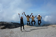 Happy people jumping in the air on Mt. Kilimanjaro