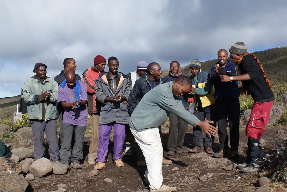 Kilimanjaro mountain crew celebrating a successful climb