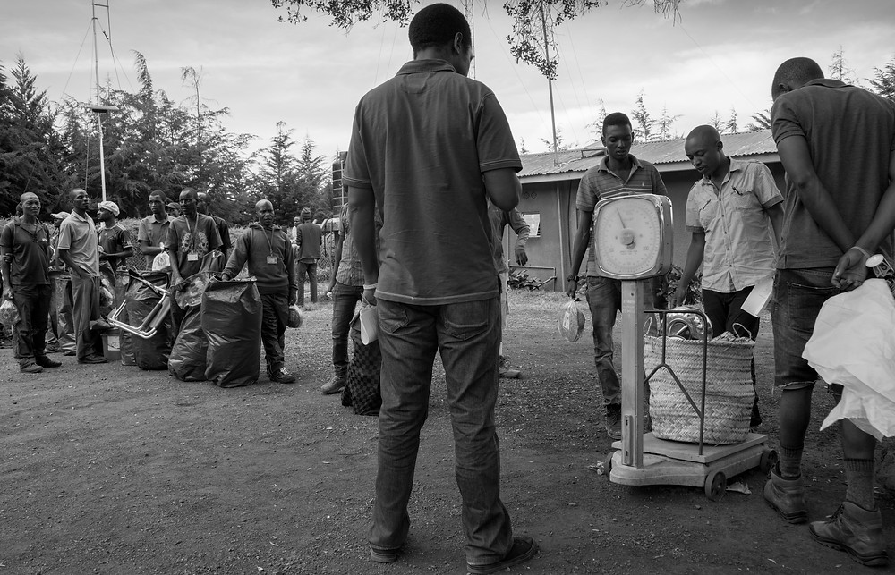 Luggage being weighed at the Kilimanjaro Park entrance to ensure it does not exceed 20kg