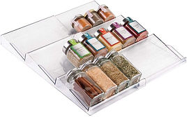 Spices organized on clear plastic drawer riser