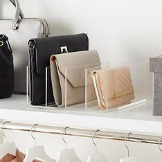 Clutch purses in plastic divider