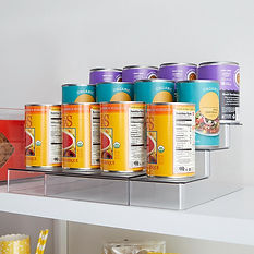 Cans neatly stacked on clear plastic shelf riser