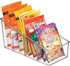Spice packets standing upright in a packet organizer
