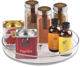 Clear plastic lazy Susan holding spices