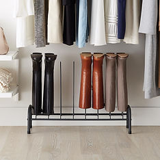 Three pairs of boots upright on boot holder