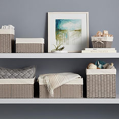 Cloth-lined gray baskets on two shelves