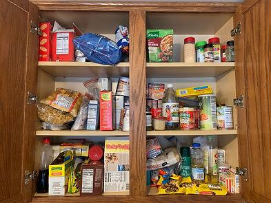 Unorganized pantry cabinets