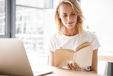 bigstock-Smiling-businesswoman-reading-2