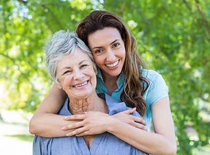 mother and grandmother smilling in a par