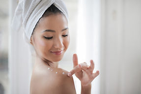 Canva - Topless Woman Putting Moisturize