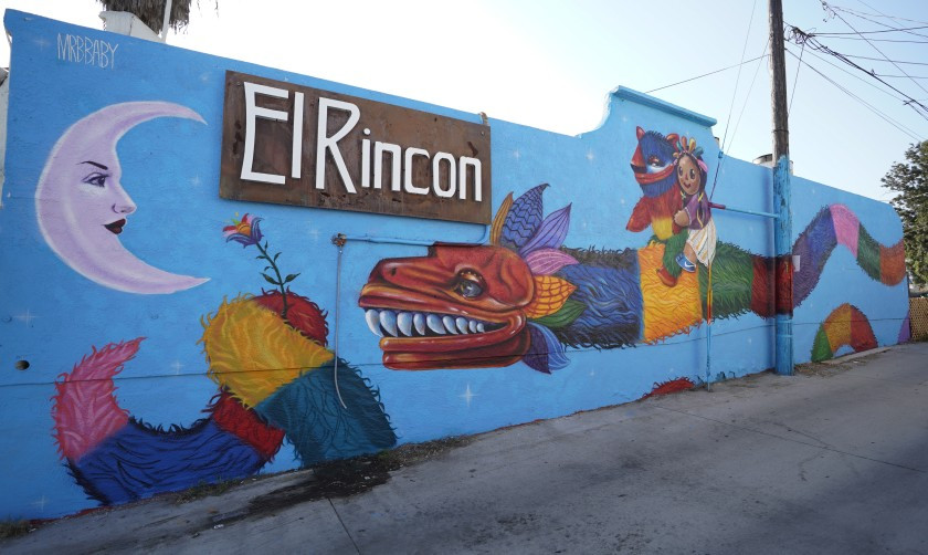 "Artist Michelle Guerrero, also known as Mrbbaby, recently finish this mural, called ""Quetzalcoatl falls in love with the moon"" at El Rincón Restaurant.(Alejandro Tamayo/The San Diego Union-Tribune)"