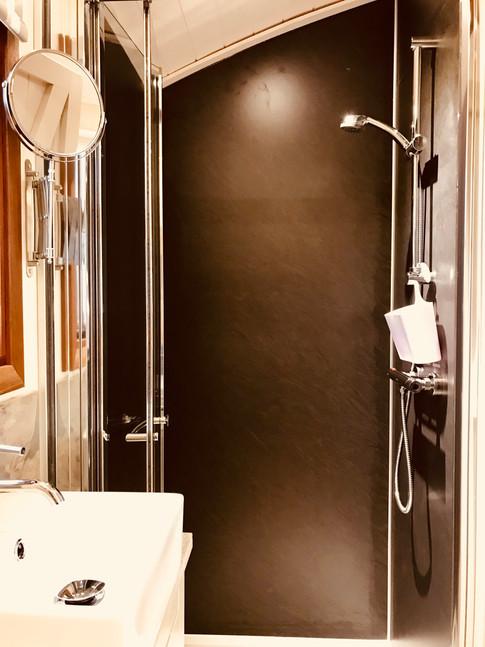 A proper shower room inside the cabin!