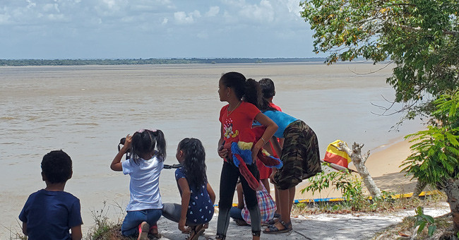 Children observing parrots from their village in Guyana