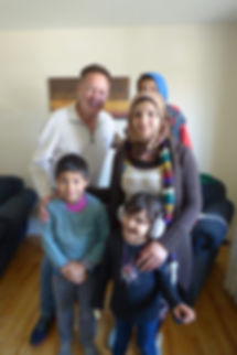 Channel of Peace author Kevin Tuerff with happy Syrian refugee family in Gander, Newfoundland