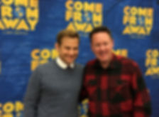 Channel of Peace author Kevin Tuerff with his doppelganger, actor Chad Kimball in front of Come From Away backdrop