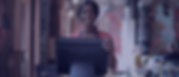 cheerful-black-waitress-standing-at-coun