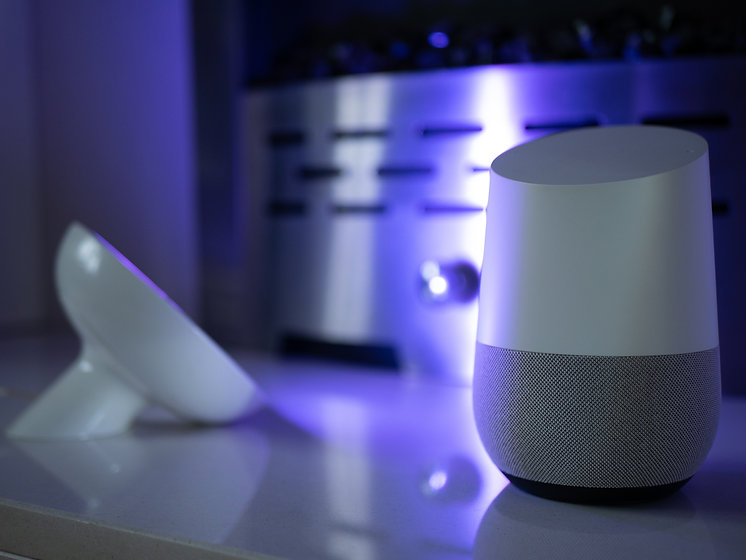 smart-home-speaker-device-lit-with-colou