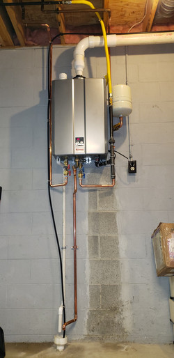 Tankless Water Heater Installation by Pena