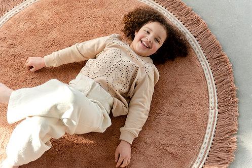 שטיח עגול בצבע ורוד מעושן