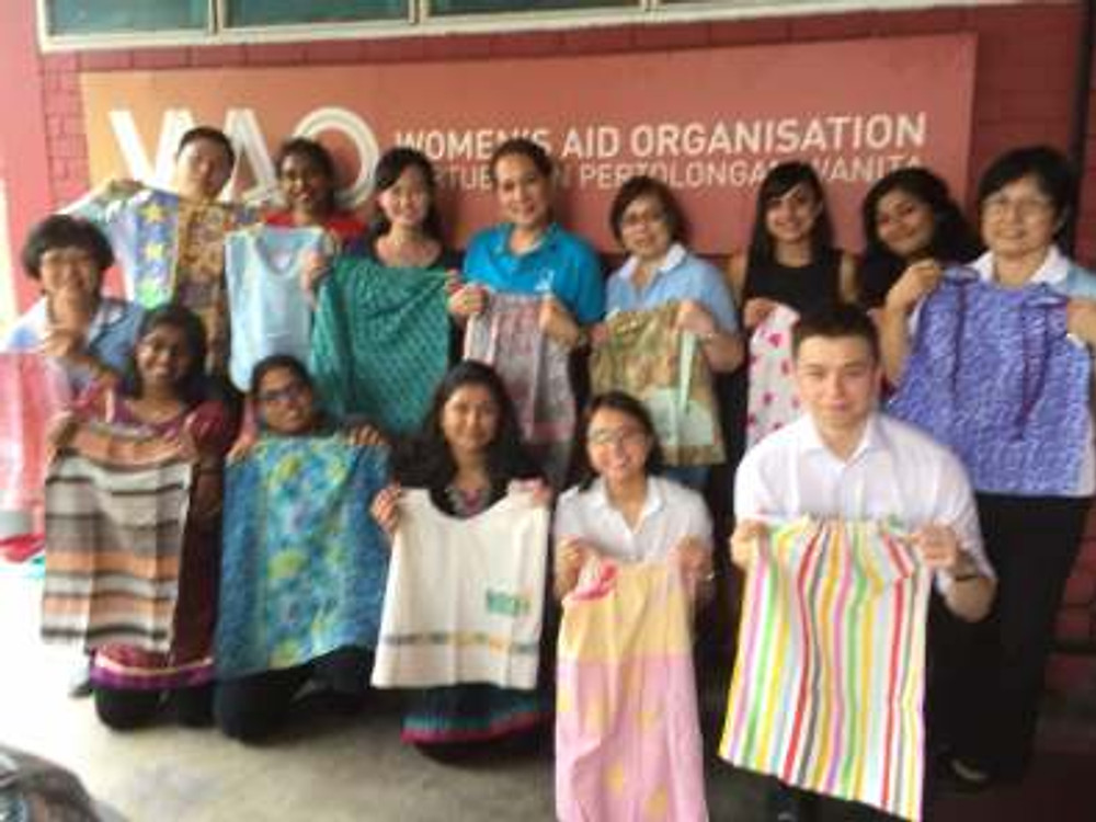 Presentation of girls' dresses to WAO during visit of Regional Director (Region 18)