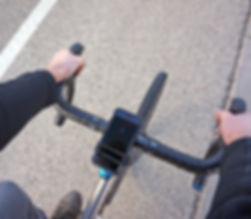 A cyclist using an app to navigate