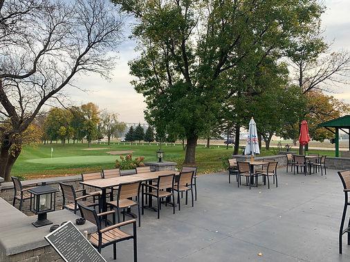 Patio outside Sleepy Eye Golf Club overlooking hole 9 green