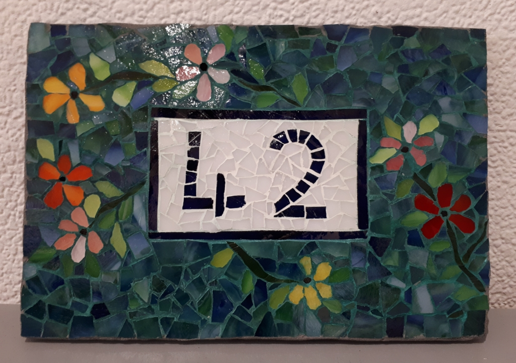 Plaque de rue en mosaïque Christiane