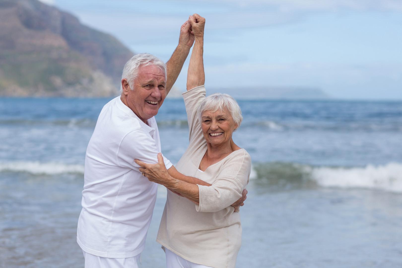 senior-couple-having-fun-together-at-bea