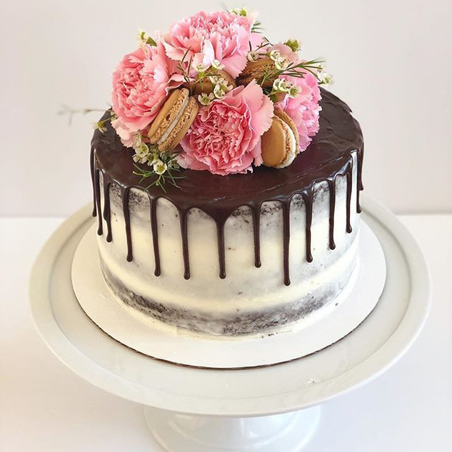Naked Drip Cake with Fresh Flowers and Macaroons