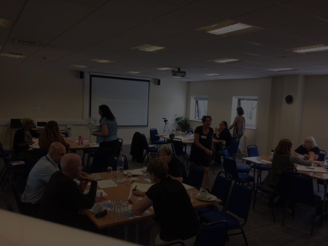 A room of people seated round tables discussing ideas at the SRANE Middlesbrough workshop