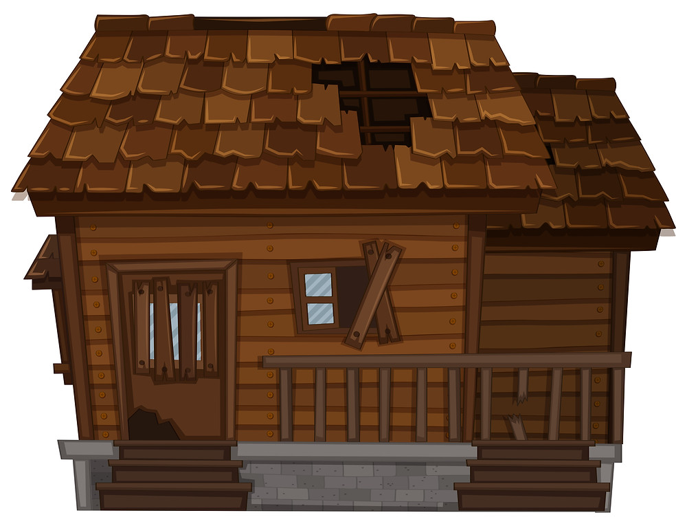 Old wooden house with roof tiles missing and boarded up window