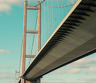 A photo of the Humber Bridge against a blue sky backdrop