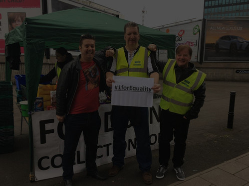 Three men from NUFC Fans Foodbank holding a sign saying '#1forEquality'