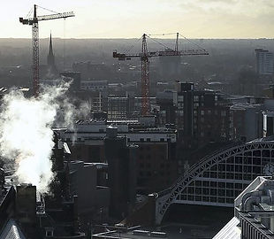 The Manchester skyline - including houses, cranes and a cathedral spire