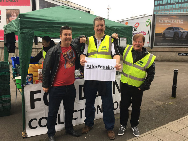 Three men from NUFC fans foodbank holding a sign syaing #1forEquality