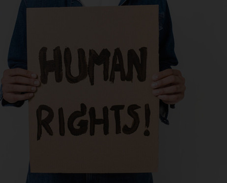 A man holding a sign saying 'Human Rights'