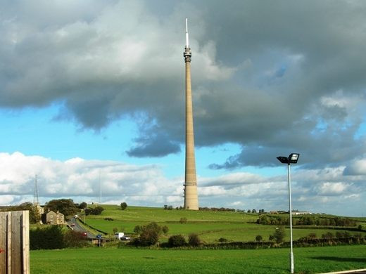 Emley Moor Transmitter Mast stands on a hill like a pike heading towards the sky