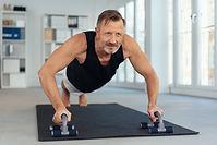 Older man doing fitness, fitness after 50