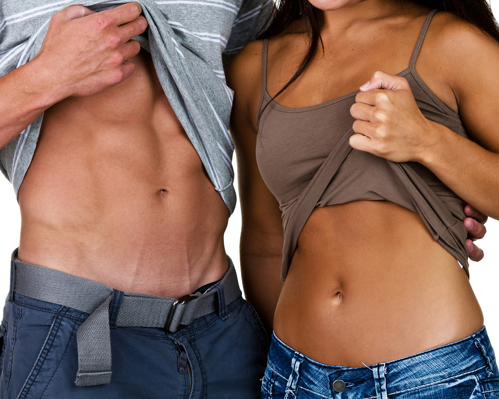 Couple showing flat stomach, fitness after 50