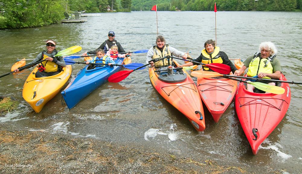adaptive kayak with kayak ores and kayak outriggers