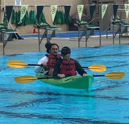 Dana and student instructor paddling in Cal Poly pool